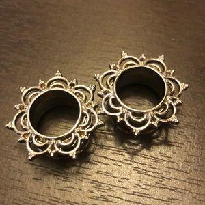 Silver mandala ear tunnels
